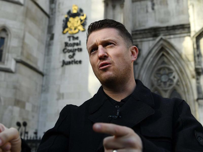 Tommy Robinson tells supporters to vote for Boris Johnson's Conservative Party outside the High Court in London: EPA/Andy Rain