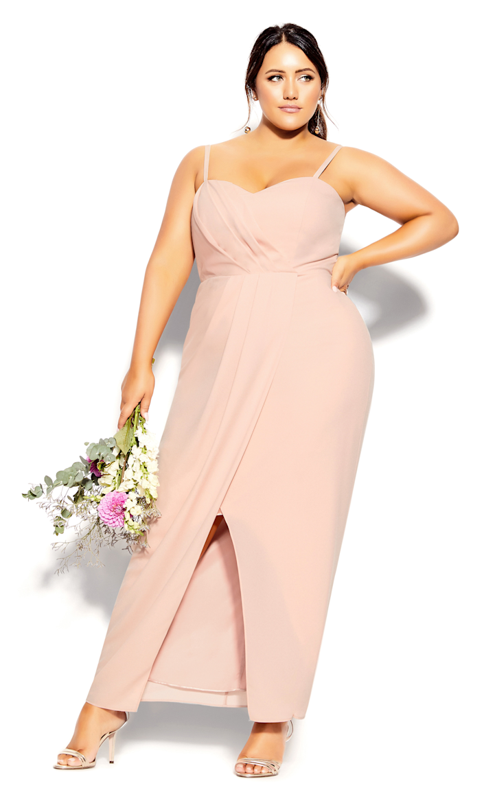 """<h3><strong>City Chic</strong></h3><br><strong>Price Range:</strong> $69 - $189<br><strong>Size Range:</strong> 12 - 24<br><br>Plus-size retailer City Chic offers a variety of simple and elegant bridesmaids' dresses in plenty of colorways. We love this <a href=""""https://www.citychiconline.com/plus-size-maxi-sweet-drape-201952balletpink"""" rel=""""nofollow noopener"""" target=""""_blank"""" data-ylk=""""slk:ballet pink number"""" class=""""link rapid-noclick-resp"""">ballet pink number</a> (which you can also snag in black, ivory, or powder blue) for a daytime, outdoor affair.<br><br><em>Shop <strong><a href=""""https://www.citychiconline.com/weddings/bridesmaids/"""" rel=""""nofollow noopener"""" target=""""_blank"""" data-ylk=""""slk:City Chic"""" class=""""link rapid-noclick-resp"""">City Chic</a></strong></em><br><br><strong>City Chic</strong> Sweet Drape Maxi Dress, $, available at <a href=""""https://go.skimresources.com/?id=30283X879131&url=https%3A%2F%2Fwww.citychiconline.com%2Fplus-size-maxi-sweet-drape-201952balletpink"""" rel=""""nofollow noopener"""" target=""""_blank"""" data-ylk=""""slk:City Chic"""" class=""""link rapid-noclick-resp"""">City Chic</a>"""