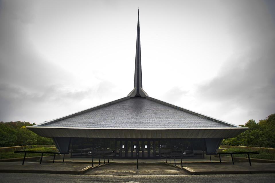 An exterior photo of the North Christian Church as its dramatic spire appears to part the clouds in Columbus, Ind.