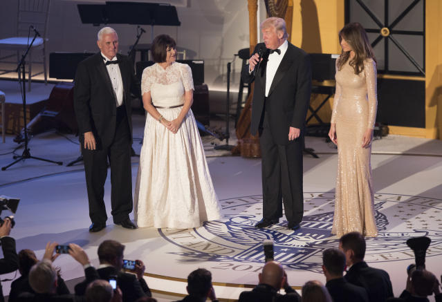 Second lady Karen Pence wore a white gown to a 2017 ball with husband Mike Pence and President and Melania Trump. (Photo: Getty Images)