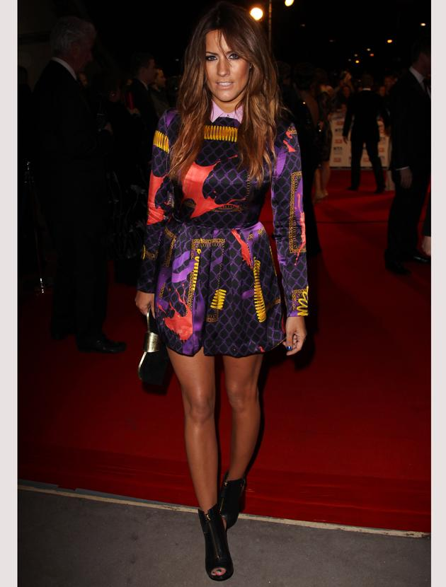 National TV Awards 2012 photos: Caroline Flack stuck to her trademark trend of a long-sleeved high-necked dress and bare legs. She accessorised with peep toe ankle boots.