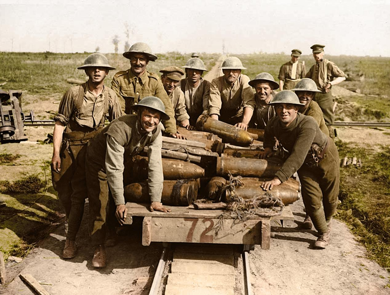<p>Royal Garrison Artillery gunners pushing a light railway truck filled with shells, behind Zillebeke, Belgium, in October 1917. (Tom Marshall/mediadrumworld.com) </p>