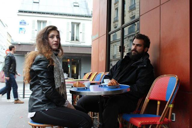 Siblings Mohammad and Anmar Hijazi at a café in Paris on the morning of the French presidential election. (Photo: Shawn Carrié)