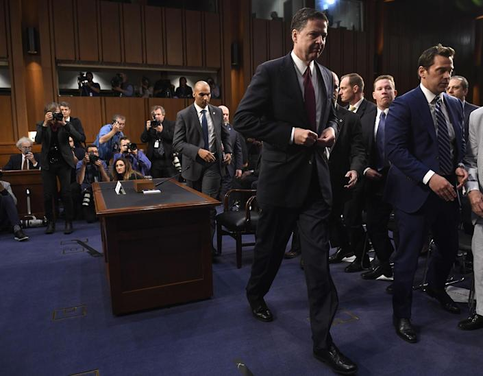 <p>Former FBI Director James Comey leaves after testifying before the US Senate Select Committee on Intelligence hearing on Capitol Hill in Washington, DC, June 8, 2017. (Photo: Saul Loeb/AFP/Getty Images) </p>