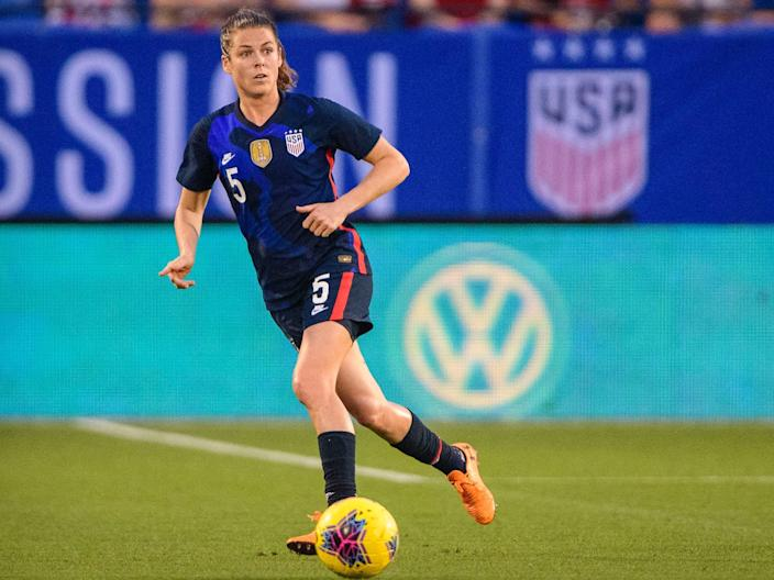 Kelley O'Hara dribbles the ball.