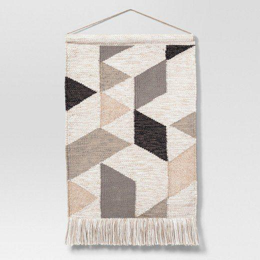 """<a href=""""https://www.target.com/p/woven-wall-hanging-copper-neutral-18-x31-project-62/-/A-50911805#lnk=newtab"""" target=""""_blank"""">Shop it here</a>."""