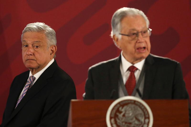 Mexico's President Andres Manuel Lopez Obrador stands next Federal Commission of Electricity (CFE) Director Manuel Bartlett during a news conference at the National Palace in Mexico City, Mexico, December 9, 2019. REUTERS/Edgard Garrido