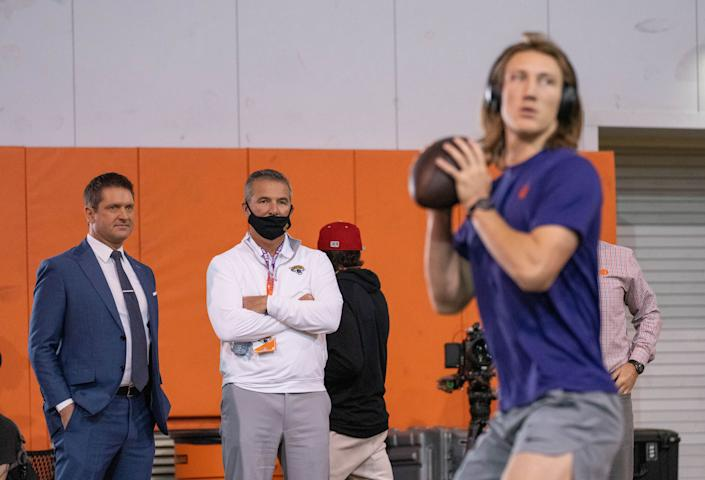 Jacksonville Jaguars head coach Urban Meyer (middle) watches as Clemson Tigers quarterback Trevor Lawrence works out during pro day in Clemson, South Carolina in February. (David Platt/Handout Photo via USA TODAY Sports)