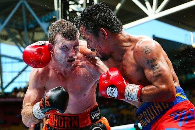 Jeff Horn (left) of Australia fights Manny Pacquiao of the Philippines in Brisbane on July 2. Australian Jeff Horn's shock welterweight title victory over Manny Pacquiao was confirmed on July 11 after a scoring review by the World Boxing Organization (AFP Photo/PATRICK HAMILTON)