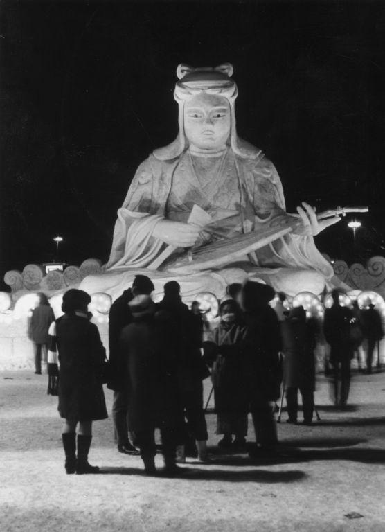 Visitors to the 22nd Sapporo Snow Festival on the island of Hokkaido in Japan admire an ice statue of Benten, a goddess of luck, music, eloquence, art and fortune.