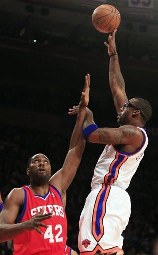 New York Knicks' Amare Stoudemire, right, shoots over Philadelphia 76ers' Elton Brand during the first half of an NBA basketball game, Wednesday, Jan. 11, 2012, in New York. (AP Photo/Frank Franklin II)