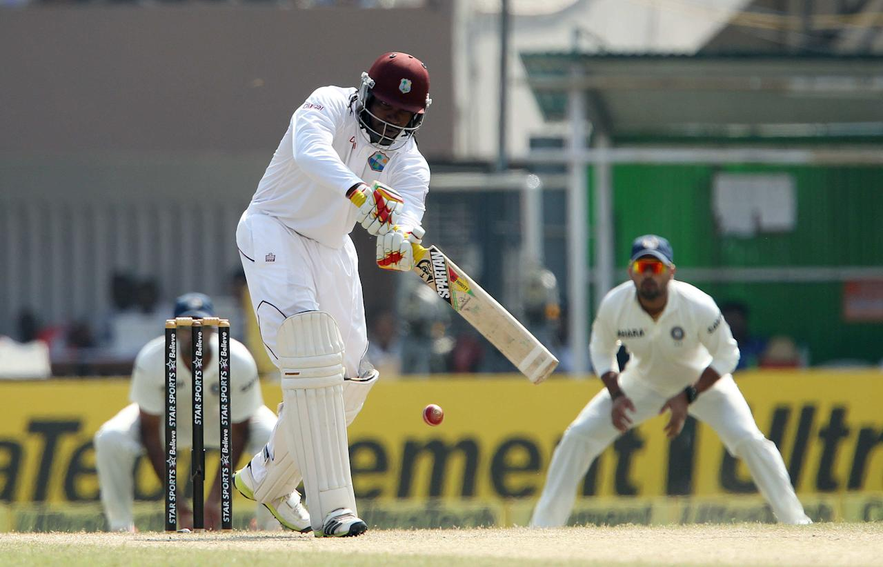 Chris Gayle of West Indies  during day three of the first Star Sports test match between India and The West Indies held at The Eden Gardens Stadium in Kolkata, India on the 8th November 2013  Photo by: Ron Gaunt - BCCI - SPORTZPICS