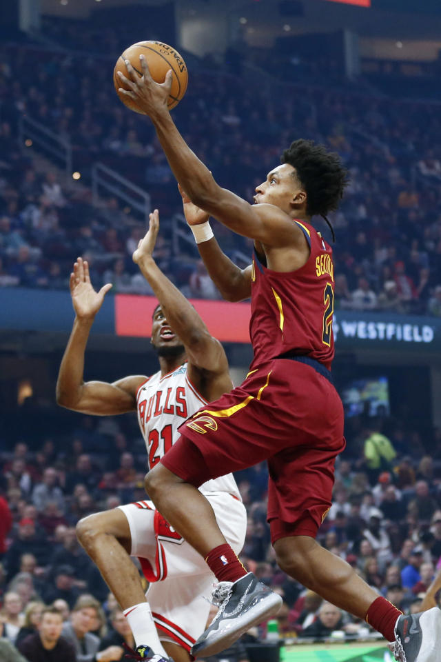 Cleveland Cavaliers' Collin Sexton (2) goes up for a shot against Chicago Bulls' Thaddeus Young (21) in the first half of an NBA basketball game, Saturday, Jan. 25, 2020, in Cleveland. (AP Photo/Ron Schwane)
