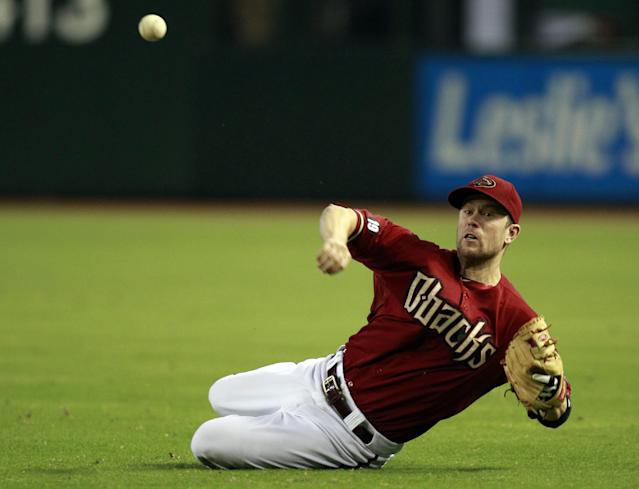 Arizona Diamondbacks second baseman Aaron Hill makes the throw for the out against the New York Mets in the sixth inning during a baseball game on Sunday, Aug. 11, 2013, in Phoenix. (AP Photo/Rick Scuteri)