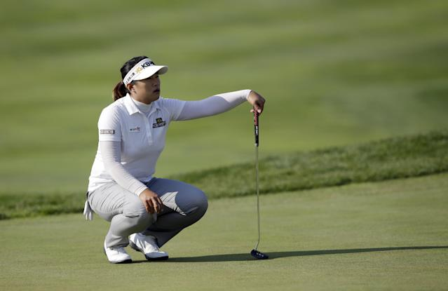 Amy Yang of South Korea lines up a putt on the ninth hole during the first round of the LPGA KEB Hana Bank Championship golf tournament at Sky72 Golf Club in Incheon, west of Seoul, South Korea, Friday, Oct. 18, 2013. Yang finished her first round in the lead with Katherine Hull-Kirk of Australia, Park Ju-young of South Korea and Anna Nordqvist of Sweden, with a five-under par 67. (AP Photo/Lee Jin-man)