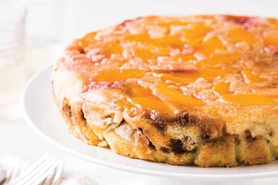 """Starting with a rich brown sugar glaze that infuses flavor throughout, this slow cooker dessert recipe combines all of the elements that make a traditional <a href=""""https://www.epicurious.com/expert-advice/upside-down-cakes-lemon-dried-fruit-article?mbid=synd_yahoo_rss"""" rel=""""nofollow noopener"""" target=""""_blank"""" data-ylk=""""slk:upside-down cake"""" class=""""link rapid-noclick-resp"""">upside-down cake</a> so irresistible. <a href=""""https://www.epicurious.com/recipes/food/views/gingersnap-peach-upside-down-cake?mbid=synd_yahoo_rss"""" rel=""""nofollow noopener"""" target=""""_blank"""" data-ylk=""""slk:See recipe."""" class=""""link rapid-noclick-resp"""">See recipe.</a>"""