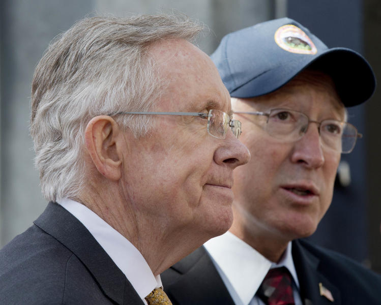 "Senate Majority Leader Harry Reid, left, and Interior Secretary Ken Salazar answer questions during a news conference, Friday, Oct. 12, 2012, in Las Vegas, in which he and Salazar announced a plan that sets aside 285,000 acres of public land for the development of large-scale solar power plants. The government is establishing 17 new ""solar energy zones"" on 285,000 acres in six states: California, Nevada, Arizona, Utah, Colorado and New Mexico. Most of the land,153,627 acres, is in Southern California. (AP Photo/Julie Jacobson)."