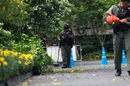 FILE PHOTO: Police Explosive Ordnance Disposal (EOD) officers work following a small explosion at a site in Bangkok