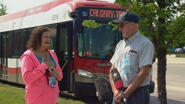 Shylow Dustin, left, had a chance to thank Calgary Transit driver Jean Paul Pouliot on Wednesday at the very spot where he came to her rescue after she had collapsed on the sidewalk last week. (Mike Symington/CBC - image credit)