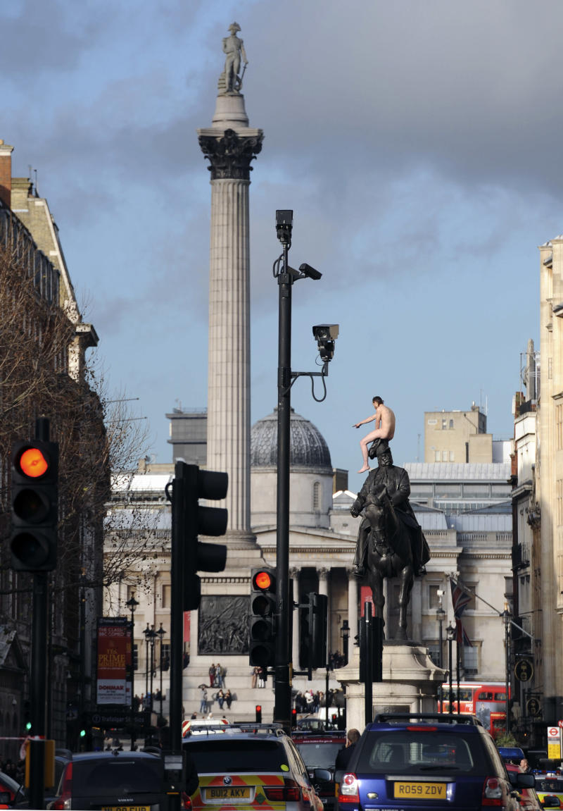 "A naked man sits on top of a statue of George, Duke of Cambridge in Whitehall, London, Friday Nov. 23, 2012.  Police and eyewitnesses say a naked man has climbed atop an equestrian statue in the heart of Whitehall, London's government district. A Scotland Yard spokesman said that the man, believed to be in his 30s or 40s, has been sitting atop the statue for the better part of two hours. He said Friday: ""We're still talking to him. We're still trying to get him down without causing any injury to him."" (AP Photo/ Stefan Rousseau/PA) UNITED KINGDOM OUT"