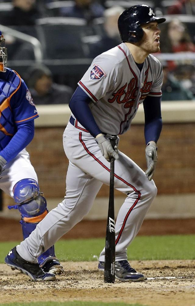 Atlanta Braves' Freddie Freeman follows through on a two-run home run during the eighth inning of a baseball game against the New York Mets, Friday, April 18, 2014, in New York. (AP Photo/Frank Franklin II)