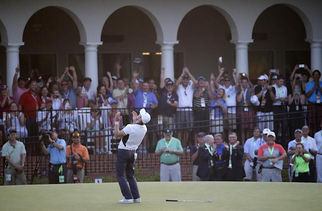 Martin Kaymer, of Germany celebrates after winning the U.S. Open golf tournament in Pinehurst, N.C., Sunday, June 15, 2014. (AP Photo/Matt York)