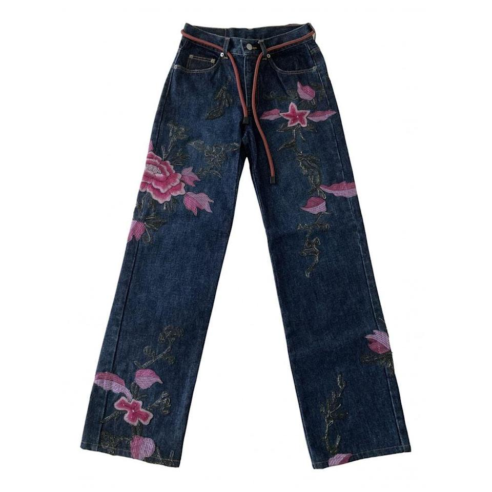 <p>Another popular online retailer for all things vintage is Vestiaire Collective, where you'll find embellished, embroidered, and hand-painted jeans that have never been worn, like these <span>Straight Leg Gucci Blue Jeans</span> ($1,342) with pink blooms.</p>