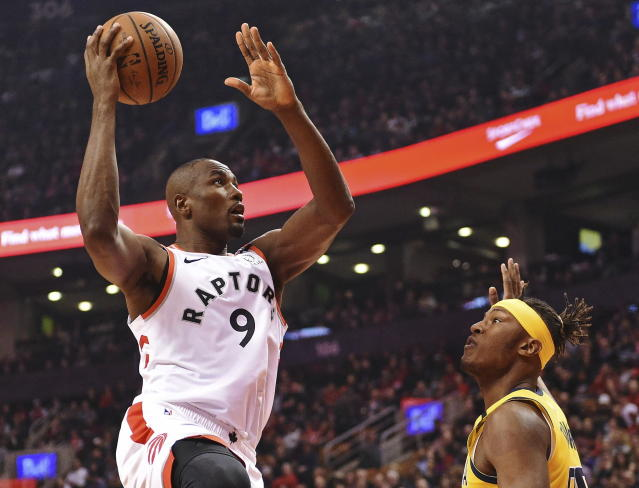 Toronto Raptors center Serge Ibaka (9) shoots over Indiana Pacers center Myles Turner (33) during first-half NBA basketball game action in Toronto, Sunday, Feb. 23, 2020. (Frank Gunn/The Canadian Press via AP)