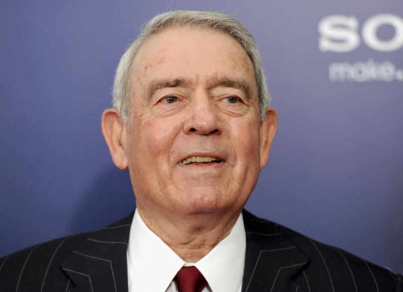 """FILE - This Oct. 5, 2011 file photo shows journalist Dan Rather at the premiere of """"The Ides of March"""" in New York. The 50th anniversary coverage of the Kennedy assassination on CBS News won't include the recollections of the longtime anchor, further proof of the lingering bitterness following Rather's messy exit and subsequent lawsuit against the network. (AP Photo/Evan Agostini, File)"""