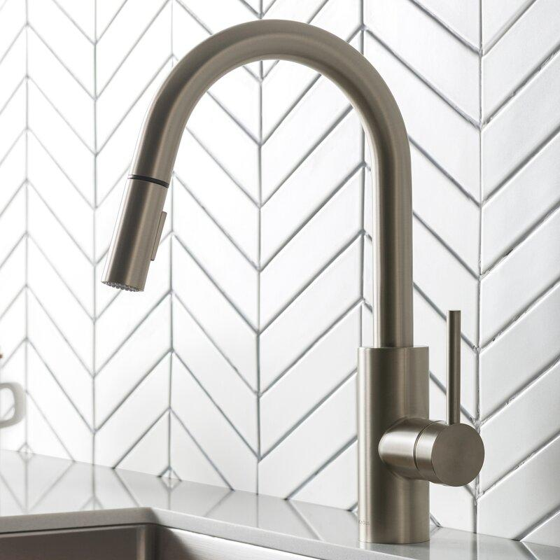 Oletto Pull Down Single Handle Kitchen Faucet with Side Spray. Image via Wayfair.