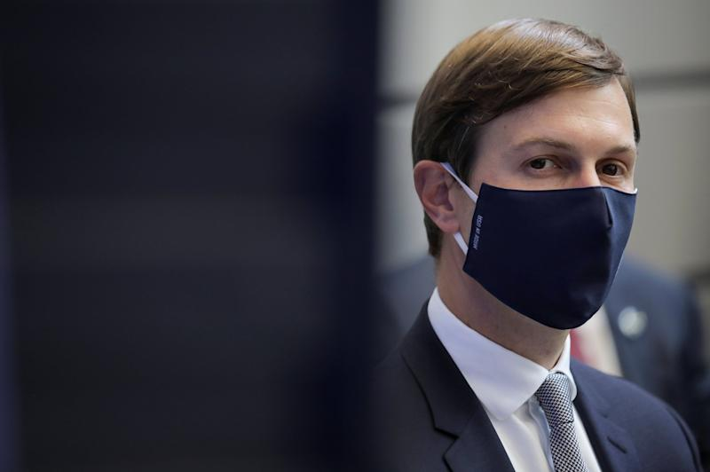 Jared Kushner watches, masked, as Donald Trump delivers a speech: REUTERS