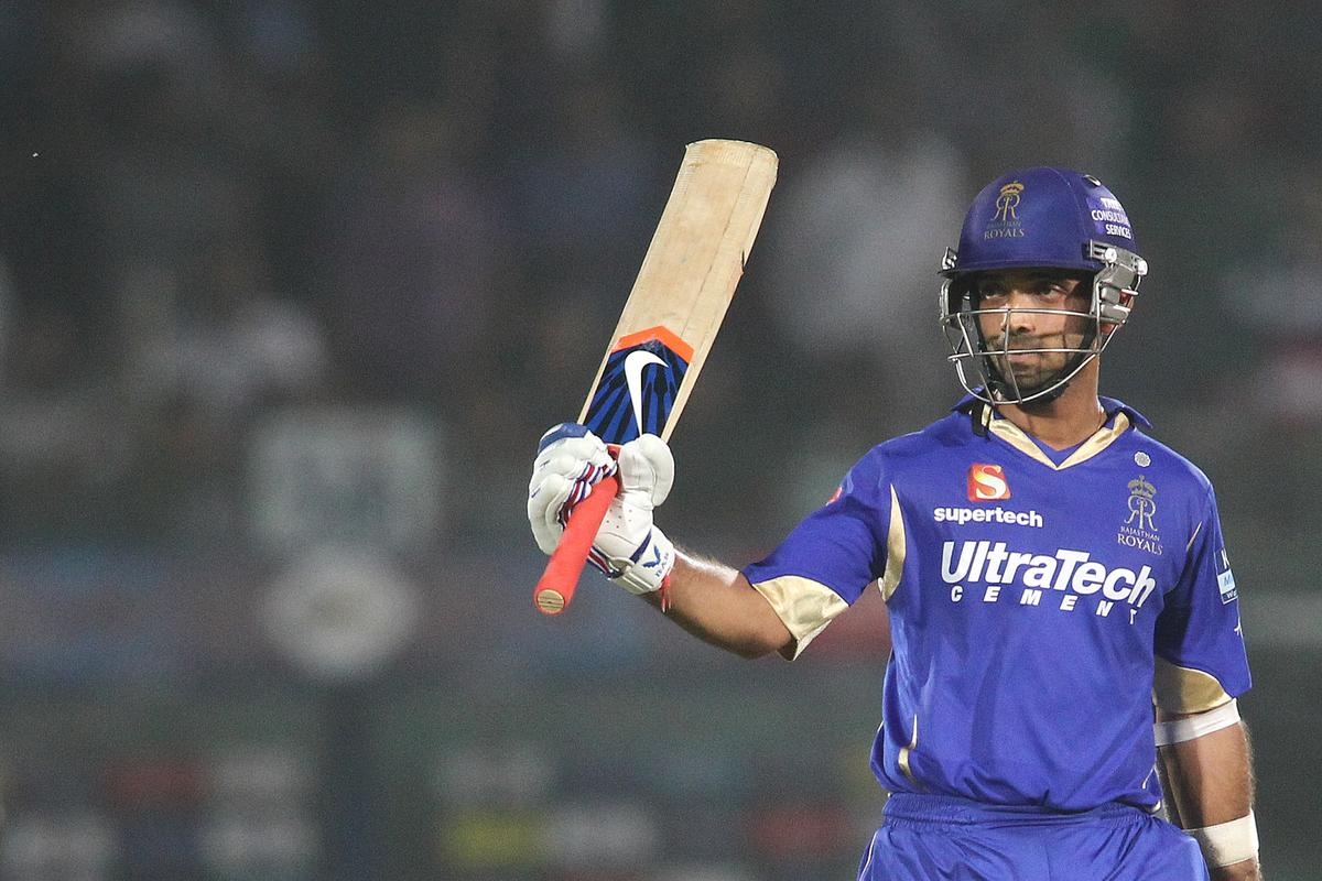 Ajinkya Rahane of Rajasthan Royals raises his bat after reaching his fifty during match 50 of the Pepsi Indian Premier League (IPL) 2013 between The Rajasthan Royals and the Pune Warriors India held at the Sawai Mansingh Stadium in Jaipur on the 5th May 2013..Photo by Shaun Roy-IPL-SPORTZPICS ..Use of this image is subject to the terms and conditions as outlined by the BCCI. These terms can be found by following this link:..https://ec.yimg.com/ec?url=http%3a%2f%2fwww.sportzpics.co.za%2fimage%2fI0000SoRagM2cIEc&t=1506242771&sig=3DtSh4tIZEQkut_84LFwEQ--~D