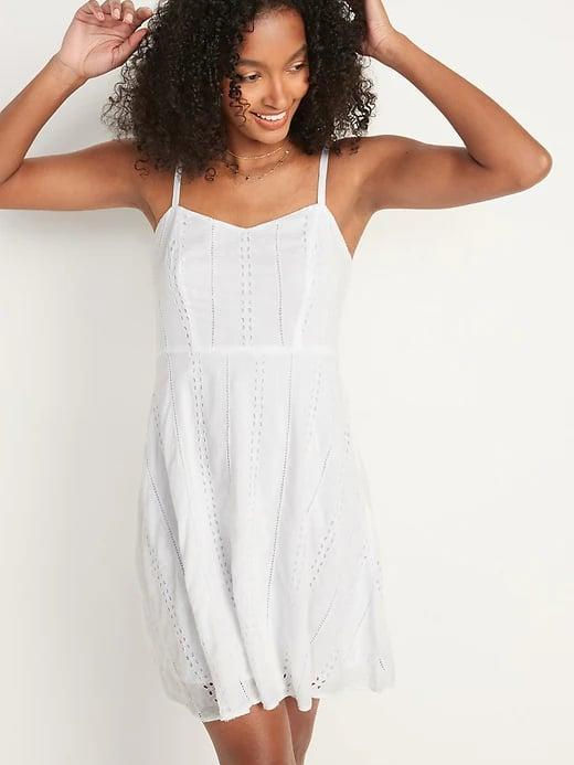 <p>If you're still searching for the perfect white sundress this season, look no further than this sweet <span>Old Navy Eyelet Cami Fit and Flare Dress</span> ($40).</p>