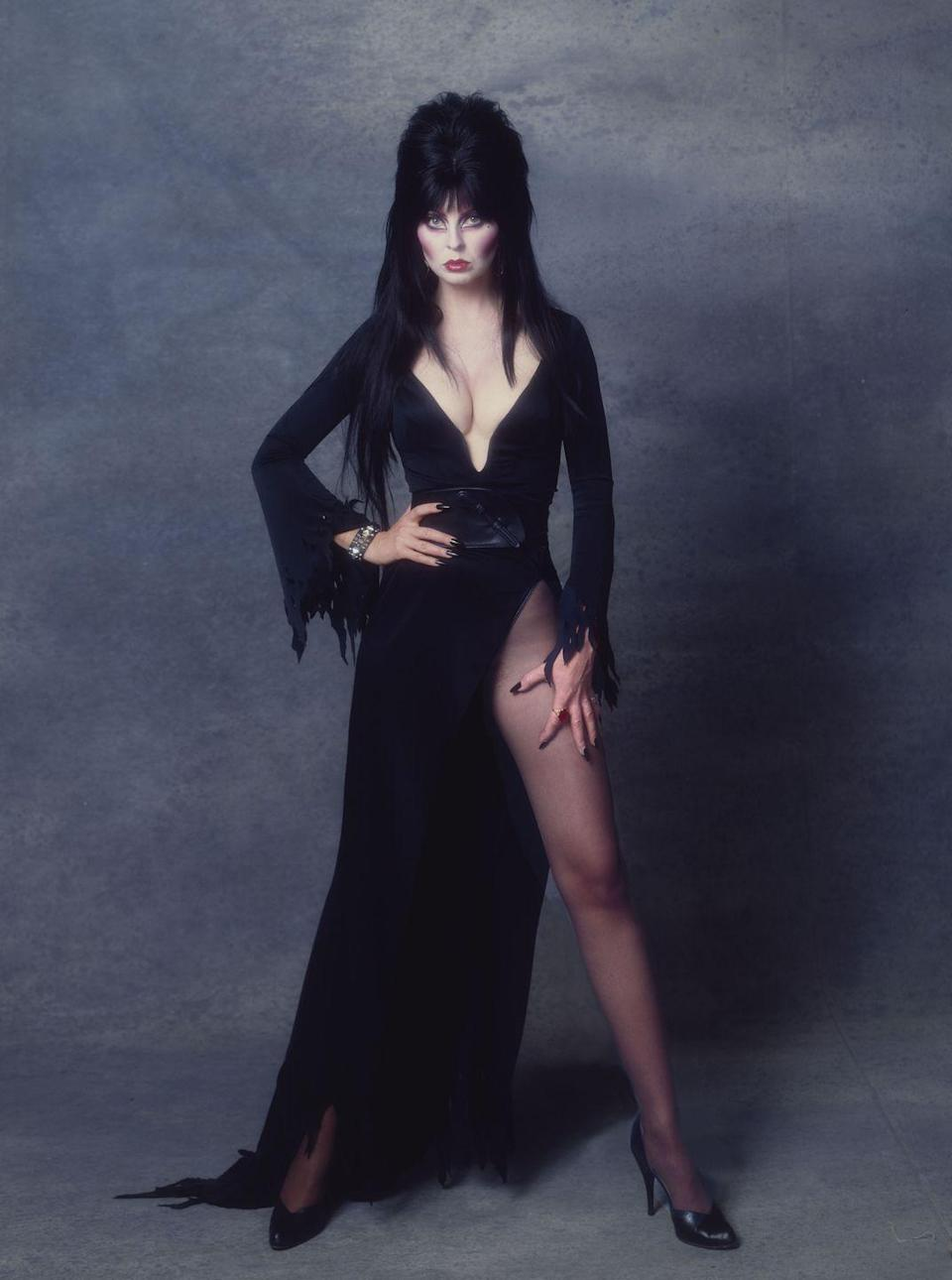 <p>The campy Mistress of Dark just gets better with age. Top it off with piles of black hair and a whole lotta leg.</p>