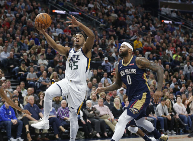 "<a class=""link rapid-noclick-resp"" href=""/nba/players/4720/"" data-ylk=""slk:DeMarcus Cousins"">DeMarcus Cousins</a> ponders his place in the cosmos as <a class=""link rapid-noclick-resp"" href=""/ncaab/players/131179/"" data-ylk=""slk:Donovan Mitchell"">Donovan Mitchell</a> leaves him behind to score two of his 40 points. (AP Photo/Rick Bowmer)"