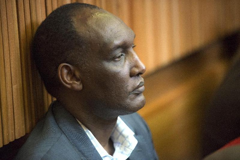 General Kayumba Nyamwasa, former Rwanda chief of staff, attends the trail of six men accused of his attempted assassination on August 28, 2014 at the Kagiso Magistrate Court in Krugersdorp, South Africa (AFP Photo/Mujahid Safodien)