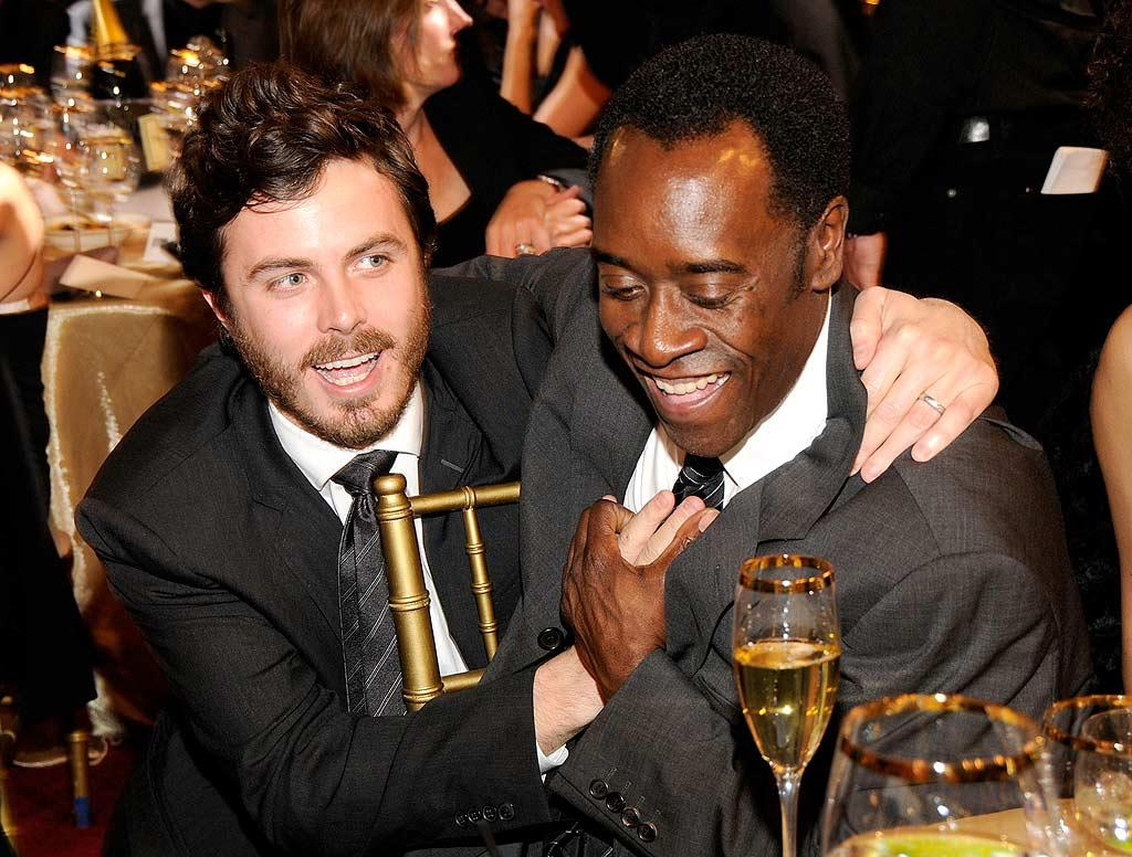 """A scruffy Casey Affleck pals around with his buddy Don Cheadle. Kevin Mazur/<a href=""""http://www.wireimage.com"""" target=""""new"""">WireImage.com</a> - January 7, 2008"""