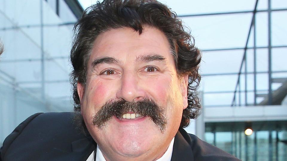 Seen here, AFL icon Robert 'Dipper' DiPierdomenico smiles for a photo.