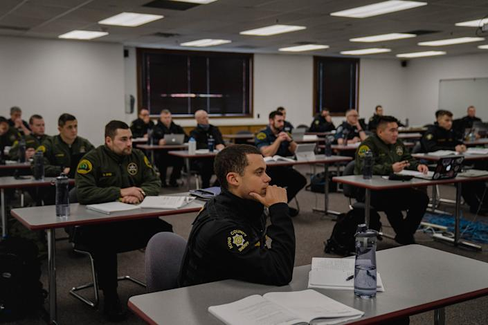 "Recruits attend a criminal law class.<span class=""copyright"">Jovelle Tamayo for TIME</span>"