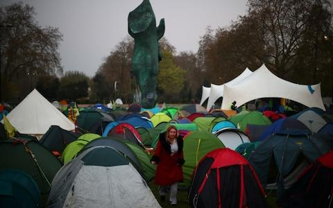 Activists set up tents at Marble Arch as part of ongoing climate change protests - Credit: Hannah McKay/Reuters