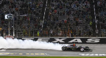 FILE - In this June 8, 2019, file photo, Josef Newgarden celebrates winning an IndyCar auto race at Texas Motor Speedway in Fort Worth, Texas. IndyCar is getting ready for an all-in-one-day season opener on the fast track in Texas, more than 2 ½ months after drivers were set to roll on the streets of St. Pete. The pandemic-delayed season is now set to open Saturday, June 6, 2020. (AP Photo/Randy Holt, File)