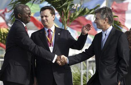 Lago's Mayor Fashola greets Buenos Aires' Mayor Macri as Kassab of Sao Paulo looks on during Rio+C40 Megacity Mayors Taking Action on Climate Change event in Rio de Janeiro