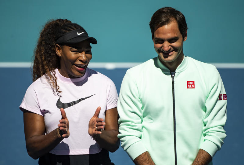 Serena Williams of the United States speaks to Roger Federer of Switzerland during the ribbon cutting ceremony on the new Stadium Court at the Hard Rock Stadium.