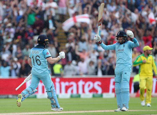 England's captain Eoin Morgan, left, and Joe Root celebrate their win over Australia in the Cricket World Cup semi-final match at Edgbaston in Birmingham, England, Thursday, July 11, 2019. (AP Photo/Aijaz Rahi)