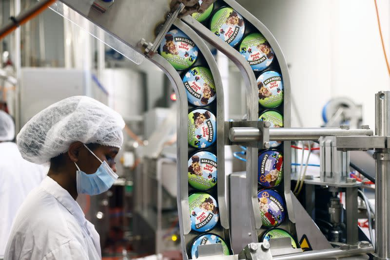 Tubs of Ben & Jerry's ice-creams are seen as a labourer works at their factory in Be'er Tuvia, Israel