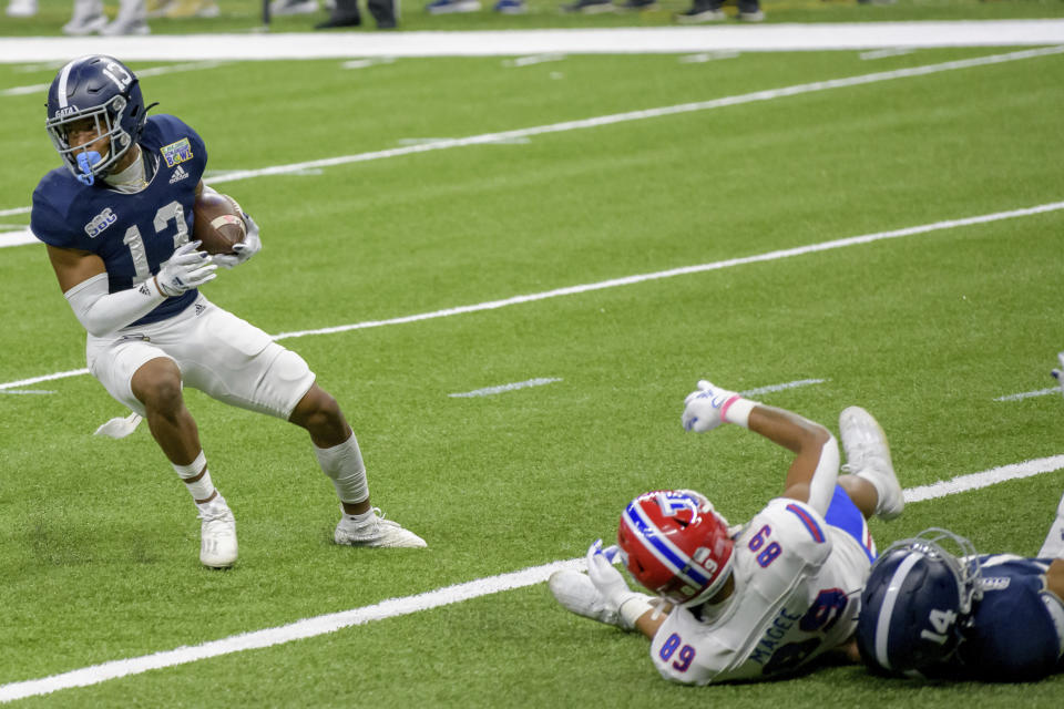 Georgia Southern cornerback Derrick Canteen (13) grabs an interception intended for Louisiana Tech wide receiver Tahj Magee (89) during the first half of the New Orleans Bowl NCAA college football game in New Orleans, Wednesday, Dec. 23, 2020. (AP Photo/Matthew Hinton)