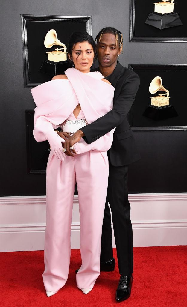 <p>Kylie Jenner accompanied her love Travis Scott, up for several of the night's awards, in a bubblegum pink Balmain Haute Couture jumpsuit with full-glove sleeves. Scott, who was set to perform, wore a blazer from Saint Laurent. </p>