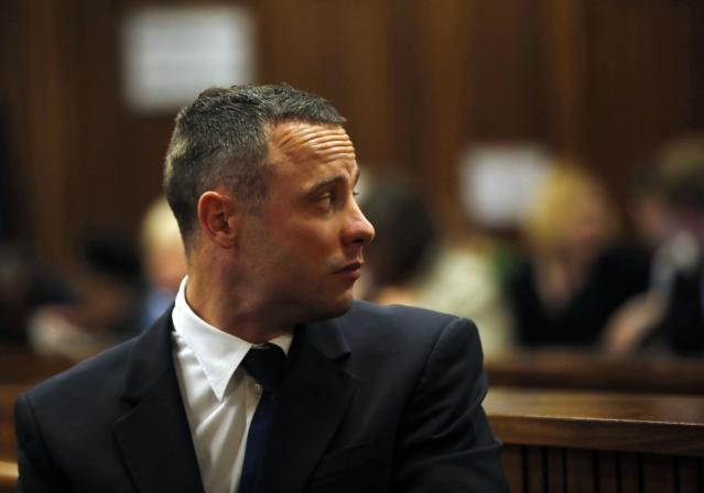 Olympic and Paralympic track star Oscar Pistorius sits in the dock in the North Gauteng High Court in Pretoria May 6, 2014. Pistorius is on trial for murdering his girlfriend Reeva Steenkamp at his suburban Pretoria home on Valentine's Day last year. REUTERS/Mike Hutchings (SOUTH AFRICA - Tags: SPORT CRIME LAW ATHLETICS)