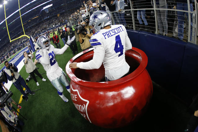 "The Salvation Army bucket is just one of the ways the organization has appeared at <a class=""link rapid-noclick-resp"" href=""/nfl/teams/dallas/"" data-ylk=""slk:Cowboys"">Cowboys</a> games. (AP Photo/Ron Jenkins)"