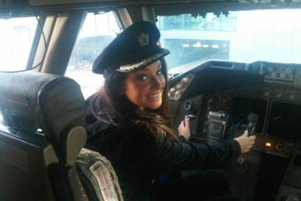 Guess who's flying your plane? Tulisa takes control in the cockpit